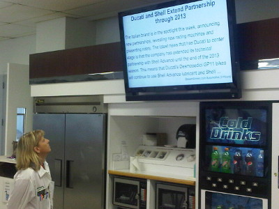 employee communication screen placed strategically over vending machine